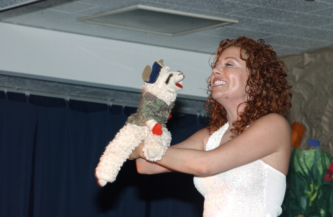 KADENA AIR BASE, Japan -- Mallory Lewis and Lamb Chop perform at Bob Hope Primary School here April 14.  Lamb Chop sported a military uniform and security forces beret to show support to servicemembers.  Ms. Lewis is the daughter of the late Shari Lewis who created the famous sock puppet.  (U.S. Air Force photo by Staff Sgt. C.E. Lewis)
