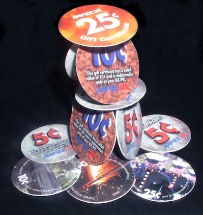 TALLIL AIR BASE, Iraq -- Army and Air Force Exchange Service's pogs are becoming collectible items for deployed servicemembers.  Because of weight, the U.S. Treasury Department does not ship coins to the Middle East; so, AAFES officials chose to make pogs in denominations of 5, 10 and 25 cents.  The pogs are about 1 inch in diameter and feature various military-themed graphics.  (U.S. Air Force photo by Tech. Sgt. Carrie Bernard)