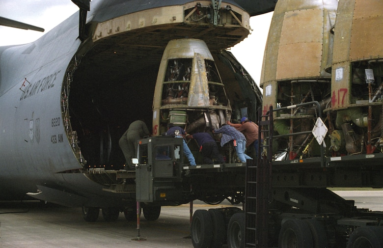 LACKLAND AIR FORCE BASE, Texas -- Airmen from the 433rd Airlift Wing here load XC-99 engines onto a C-5 Galaxy before taking them to the Air Force Museum near Wright-Patterson Air Force Base, Ohio.  (U.S. Air Force photo by 1st Lt. Bruce R. Hill Jr.)