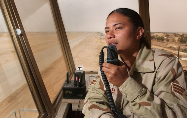 BALAD AIR BASE, Iraq -- Senior Airman Salamasina Nickel gives radio clearance for traffic crossing the taxiway here April 28.  Airman Nickel is an air traffic controller deployed with the 332nd Air Expeditionary Operations Support Squadron.  (U.S. Air Force photo by Tech. Sgt. Keith Brown)