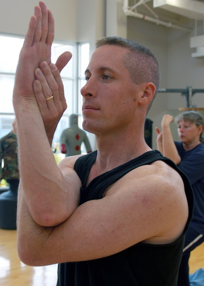 LOS ANGELES AIR FORCE BASE, Calif. -- For core-muscle strengthening, Capt. William Uhl maintains this eagle pose using abdominal and back muscles which are key to balance. He has been practicing yoga for four years and is certified to teach yoga, Pilates and Power Stretch, which combines yoga and Pilates.  The captain is an analyst for the Space and Missile Systems Center's intelligence directorate. (U.S. Air Force photo by Jason M. Webb)