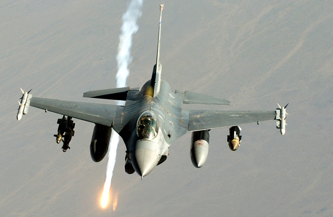 OVER IRAQ -- An F-16 Fighting Falcon dispenses a flare during a combat mission here July 23. (U.S. Air Force photo by Staff Sgt. Lee O. Tucker)