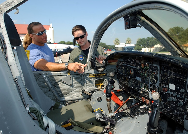 RANDOLPH AIR FORCE BASE, Texas (AFPN) -- Capt. Matt Gehrke shows professional wrestler Shawn Michaels the cockpit of a T-37 Tweet.  The wrestler, who spent a portion of his childhood here, toured the base Aug. 4.  Captain Gehrke is assigned to the 559th Flying Training Squadron.  (U.S. Air Force photo by Master Sgt. Lee Roberts)