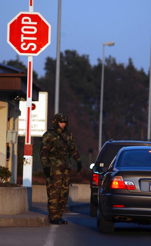 RAMSTEIN AIR BASE, Germany -- Senior Airman Sean Donovan of the 723rd Air Mobility Support Squadron directs traffic at the east gate to Ramstein Air Base, Germany. Donovan augments security forces, which pulls him away for his own job. But when German troops arrive to help at the base gates later this month, he may not have to pull gate guard duty again.  (U.S. Air Force photo by Master Sgt. John Lasky)