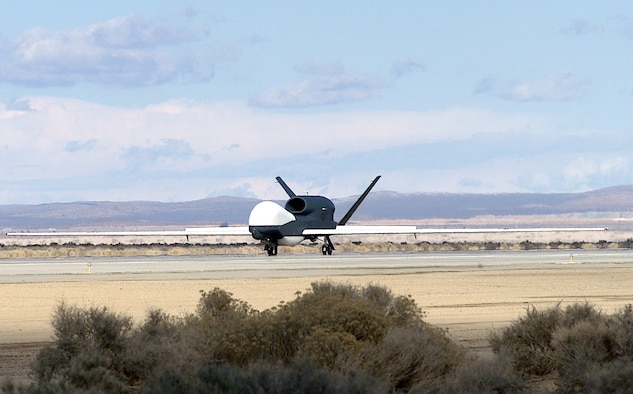 EDWARDS AIR FORCE BASE, Calif. -- The seventh Global Hawk unmanned aerial vehicle lands here after its flight from Air Force Plant 42 in nearby Palmdale, Calif., The UAV was built by lead government contractor Northrop Grumman.  (U.S. Air Force photo by Mike Charlie)
