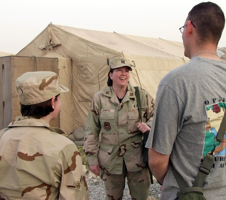 OPERATION SOUTHERN WATCH -- Chaplain (Capt.) Leslie Janovec, a Protestant chaplain assigned to the 386th Air Expeditionary Wing, visits tent city residents at her forward-deployed location in the Arabian Gulf region. Janovec recently deployed to the region from her home station at Lackland Air Force Base, Texas. (U.S. Air Force photo by Tech. Sgt. Dan Neely)