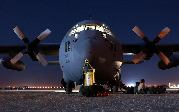 OPERATION ENDURING FREEDOM -- A C-130 Hercules, assigned to the 320th Air Expeditionary Wing at a forward-deployed location, awaits its next mission on the flightline.  The aircraft was used to perform a heavy equipment airdrop into south central Afghanistan supporting Operation Enduring Freedom.  (U.S. Air Force photo by Staff Sgt. Cherie Thurlby)