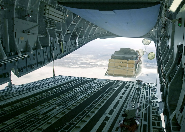 EDWARDS AIR FORCE BASE, Calif. -- An Army Stryker engineer squad vehicle equipped with a mobile gun system is airdropped Aug. 13 from a C-17 Globemaster III from the 418th Flight Test Squadron here.  (U.S. Air Force photo by Kevin Kidd)