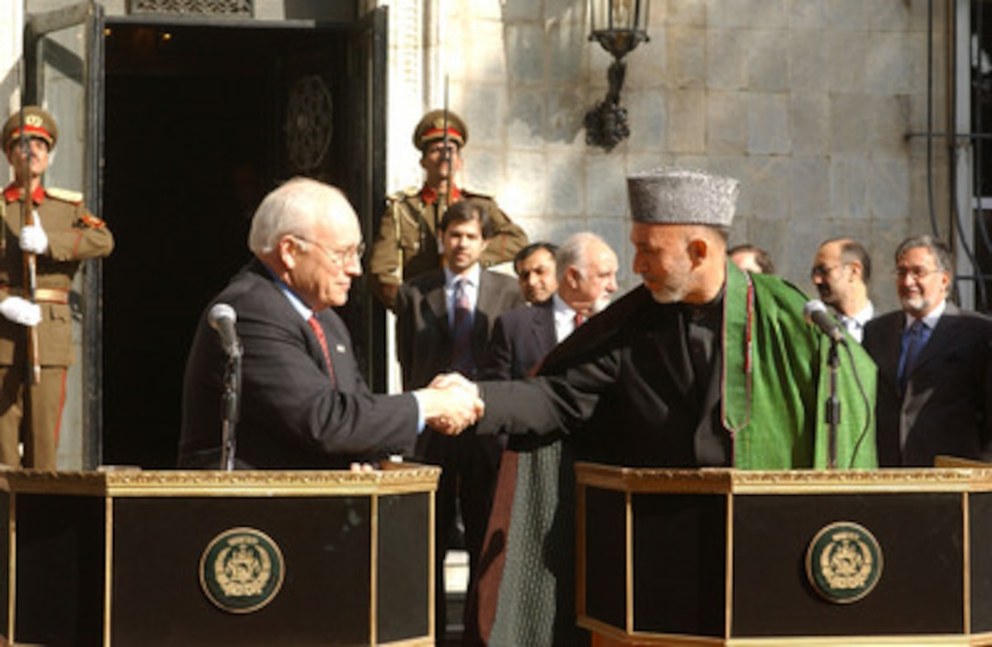 Vice President Cheney and Afghanistan President Karzai shake