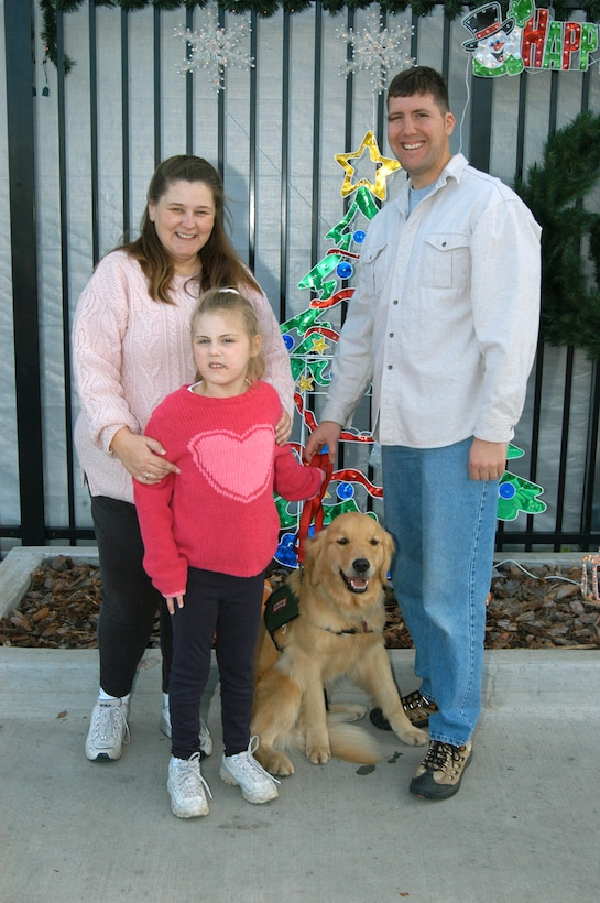 SCHRIEVER AIR FORCE BASE, Colo. -- The Rizzo family poses with Berkley.  (Courtesy photo)