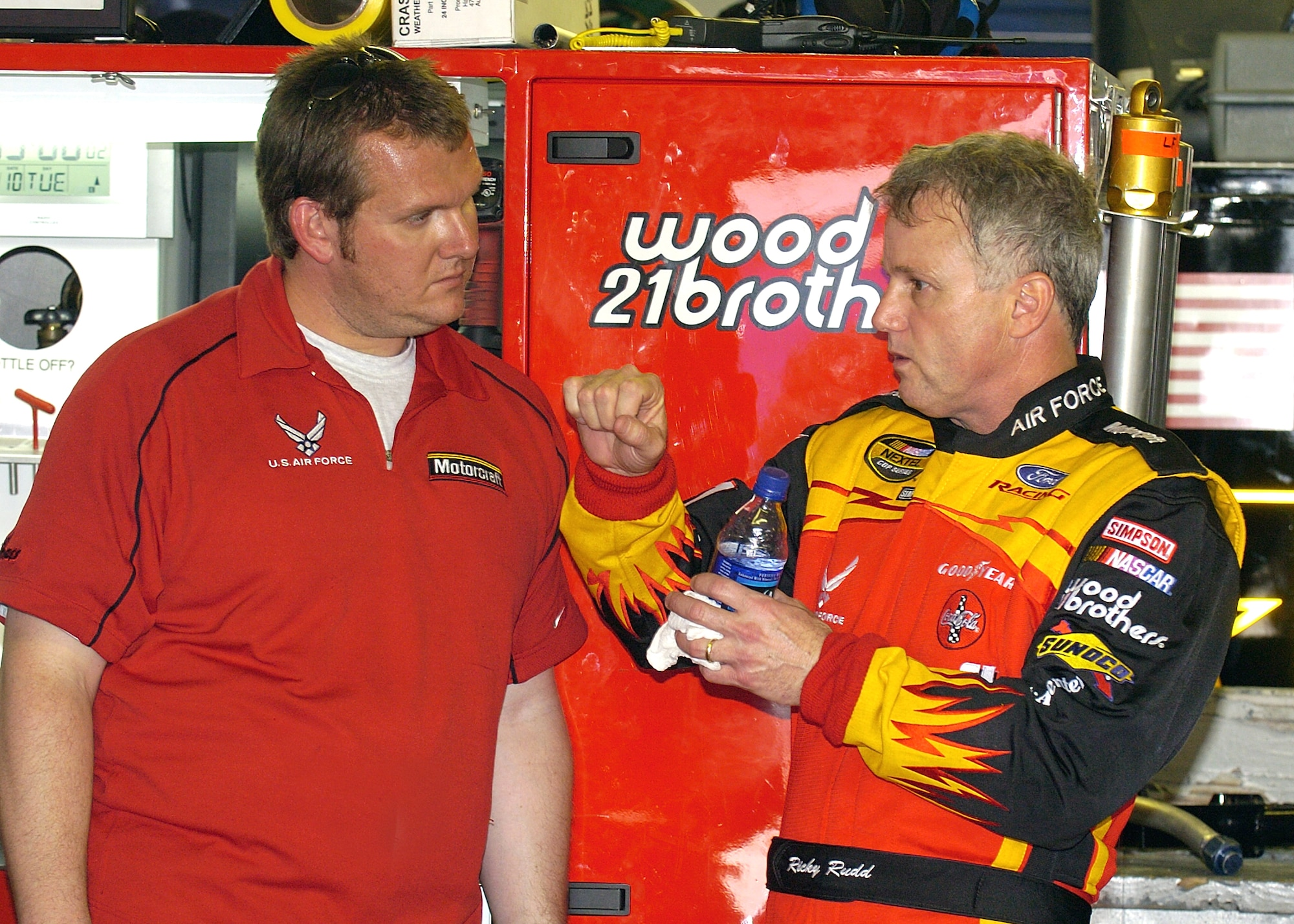 DAYTONA INTERNATIONAL SPEEDWAY, Fla. -- Ricky Rudd, driver of the Air Force-sponsored Wood Brothers Racing No. 21 Ford Taurus goes over some car-handling details with his crew chief, Ben Leslie, following a practice session at the speedway Feb. 11.  They are preparing for the Daytona 500 race, which will be held here Feb. 15.  (U.S. Air Force photo by Larry McTighe)