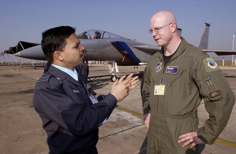 GWALIOR AIR FORCE STATION, India (AFPN) -- Squadron Leader (Dr.) M.S. Nataraja (left) discusses medical issues with Maj. (Dr.) Tim McGraw here.  Both doctors are participating in Cope India 04, a bilateral fighter training exercise between the American and Indian air forces.  Aircraft and approximately 150 airmen from Elmendorf Air Force Base, Alaska, are deployed for the exercise. (U.S. Air Force photo by Tech Sgt. Keith Brown)