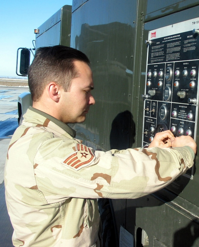 MANAS AIR BASE, Kyrgyzstan -- Staff Sgt. Aaron Schutter starts the pump motor on the de-ice truck here.  He is assigned to the 376th Air Expeditionary Wing's transient alert team.  (U.S. Air Force photo by Capt. Brus E. Vidal)