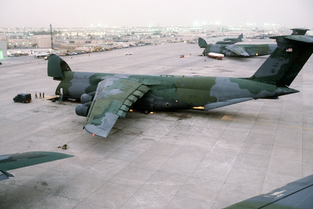 1990's -- Supplies and equipment are unloaded through the nose of a C-5A Galaxy transport aircraft of the U.S. Air Force Reserve, Military Airlift Command, in support of Operation Desert Shield.