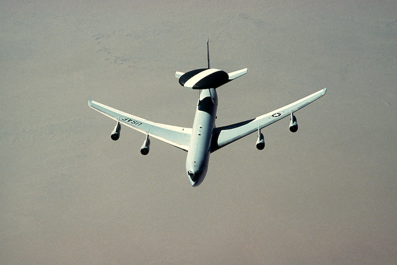 1990's -- An E-3 Sentry aircraft flies over the desert during Operation Desert Shield.