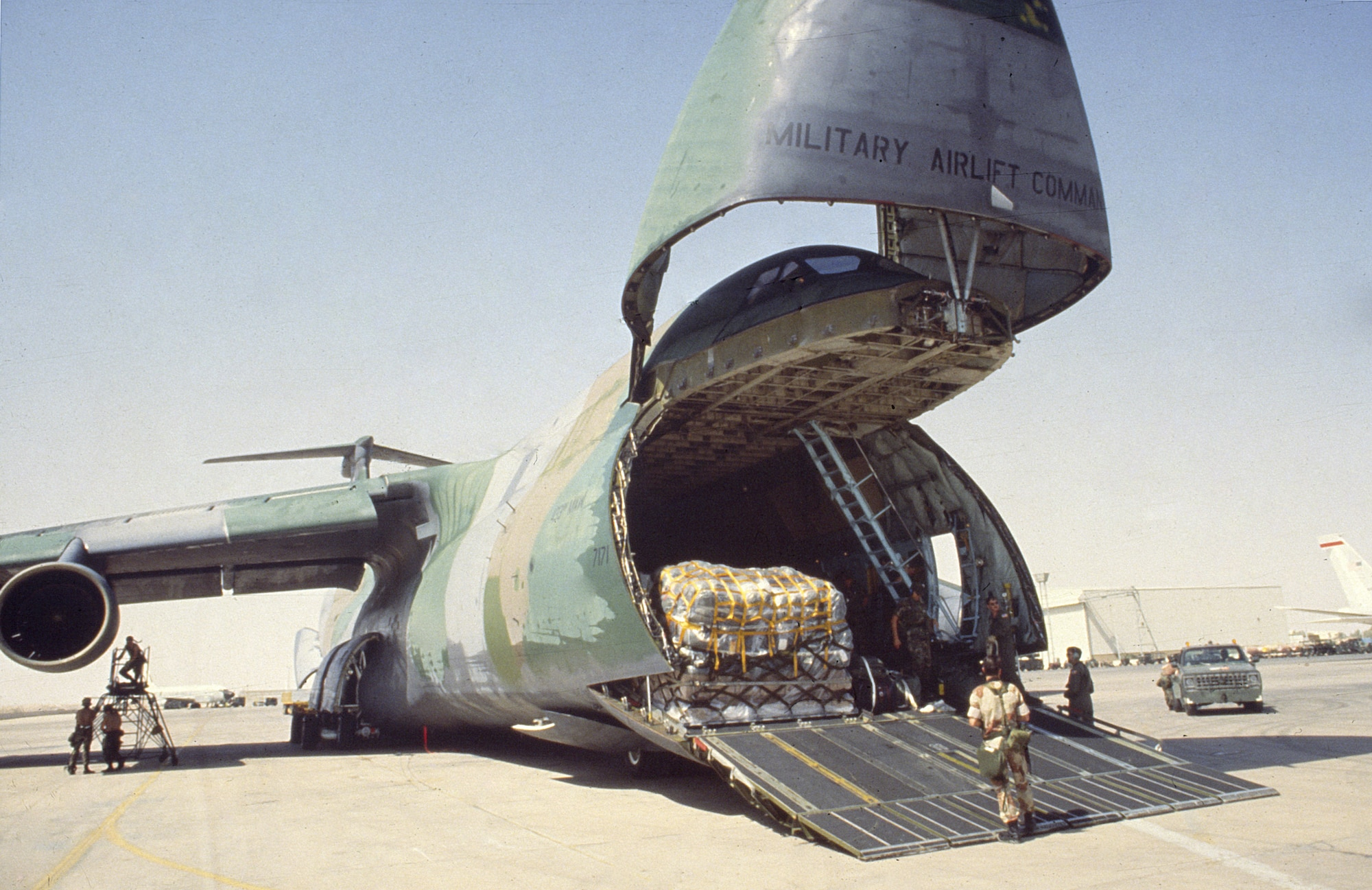 1990's -- A C-5 being loaded for an airlift to deliver cargo to troops in the desert during Desert Storm.