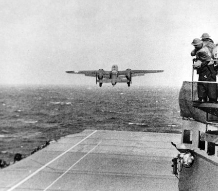 Taken from the deck of the USS Hornet (CV-8), a B-25 bomber makes its way to be part of the first U.S. air raid on Japan. (U.S. Navy photo)