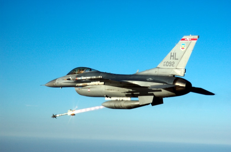 OVER THE GULF OF MEXICO -- Capt. Steve Boatright, an F-16C Fighting Falcon pilot, fires an AIM-9M Sidewinder heat-seeking missile at an aerial target drone over the Gulf of Mexico.  Captain Boatright is assigned to the 34th Fighter Squadron at Hill Air Force Base, Utah.  The squadron recently deployed to Tyndall AFB, Fla., to fly air-to-air weapons testing missions.  (U.S. Air Force photo by Master Sgt. Michael Ammons)