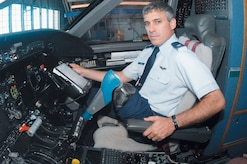 ANDREWS AIR FORCE BASE, Md. -- Lt. Col. Andrew Lourake sits in an Air Force C-20 here. Colonel Lourake underwent an above-the-knee amputation in June 2002. He was medically cleared June 18 to return to flying status and is waiting to attend formal training to get requalified to fly. (U.S. Air Force photo by Bobby Jones)
