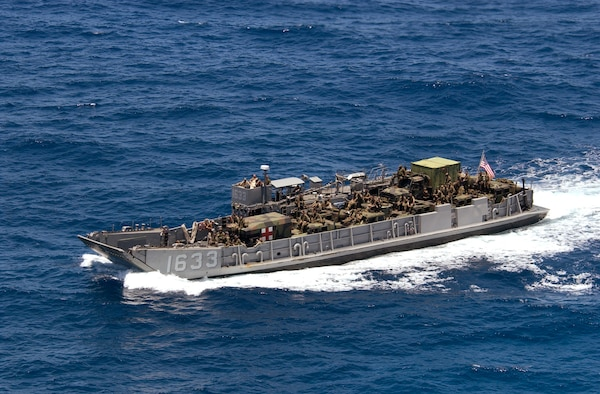 Pacific Ocean (July 20, 2004) -- A Landing Craft Utility (LCU) assigned to Assault Craft Unit One (ACU-1) inbound with embarked U.S. Marines from 3rd Marine Regiment during amphibious assault training in support of exercise Rim of the Pacific (RIMPAC) 2004. RIMPAC is the largest international maritime exercise in the waters around the Hawaiian Islands. This year's exercise includes seven participating nations; Australia, Canada, Chile, Japan, South Korea, the United Kingdom and the United States. RIMPAC is intended to enhance the tactical proficiency of participating units in a wide array of combined operations at sea, while enhancing stability in the Pacific Rim region. U. S. Navy photo by Photographer's Mate 1st Class David A. Levy