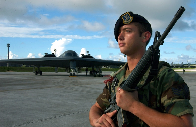ANDERSEN AIR FORCE BASE, Guam (AFPN) -- Senior Airman John Key guards an entry-control point near a B-2 Spirit bomber recently during a Coronet Bugle 49 exercise here.  Airman Key is assigned to the 509th Security Forces Squadron at Whiteman Air Force Base, Mo. He is deployed supporting B-2 operations as part of Air Combat Command's ongoing global power missions. The missions enable aircrews to train for long flights from the United States to overseas locations. (U.S. Air Force photo by Staff Sgt. Tia Schroeder)