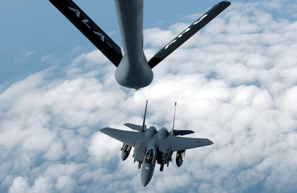 OVER THE NORTH SEA -- An F-15E Strike Eagle from the 494th Fighter Squadron at Royal Air Force Lakenheath, England, approaches the refueling boom of a KC-135 Stratotanker from the Birmingham Air National Guard's 106th Air Refueling Squadron during a training mission here July 19. (U.S. Air Force photo by Staff Sgt. Tony R. Tolley)
