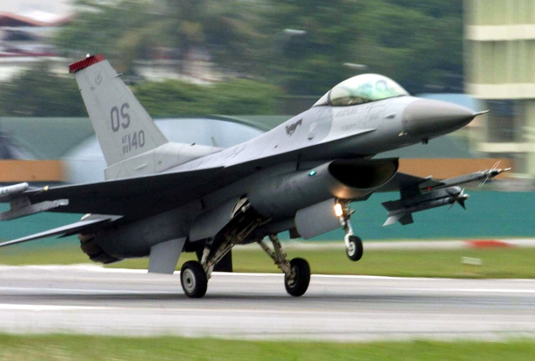 PAYA LEBAR AIR BASE, Singapore -- An F-16 Fighting Falcon from the 36th Fighter Squadron at Osan Air Base, South Korea, lands here after a mission during Commando Sling 04-3.  U.S. and Singaporean Airmen trained together using realistic dissimilar aircraft air-to-air combat tactics.  (U.S. Air Force photo by Master Sgt. Val Gempis)