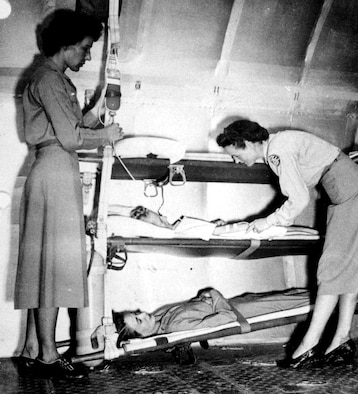 WORLD WAR II -- Although the role of the flight surgeon was developed in World War I, it was not until November 1942, when the School of Air Evacuation opened at Bowman Field, Ky., that the flight surgeon's counterpart -- the flight nurse -- became a member of the medical flight team.  Before World War II, no care was provided to wounded Soldiers during evacuation flights.  (Courtesy photo)