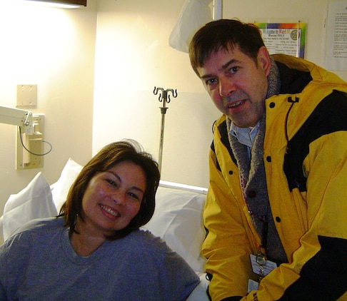 Joe Finch visits Major Tammy Duckworth at Walter Reed Army Medical Center in 2004. Duckworth is a former Army helicopter pilot whose severe combat wounds in Iraq took both her legs and damaged her right arm. She is currently the Assistant Secretary of Public and Intergovernmental Affairs for the Department of Veteran Affairs.