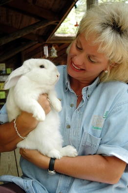 ROBINS AIR FORCE BASE, Ga. -- Sharron Wilhelm gives Lucky, a lop-eared rabbit, some tender-loving care.  Ms. Wilhelm is the supervisor for the Spalding Nature Center here.  Besides rabbits, some of the center's animals include snakes, turtles and a variety of birds.  (U.S. Air Force photo by Sue Sapp)