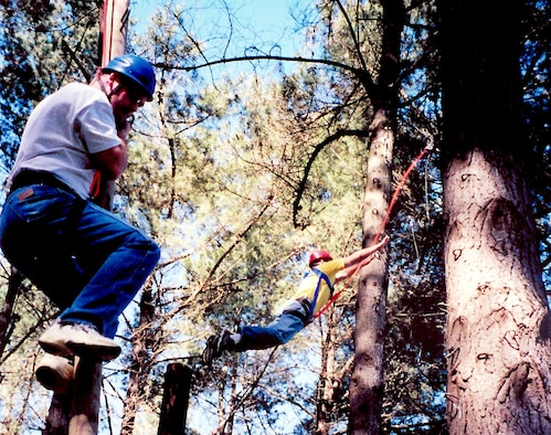 PETALUMA, Calif. -- Students at the Coast Guard Chief Petty Officer Academy here navigate the high ropes course during training.  The exercise allows students to apply what they have learned about teamwork, trust and self-confidence outside the classroom.  The academy reserves 40 slots a year for Air Force senior noncommissioned officers to attend the five-week course.  (U.S. Air Force photo by Chief Master Sgt. Brad Gildea)