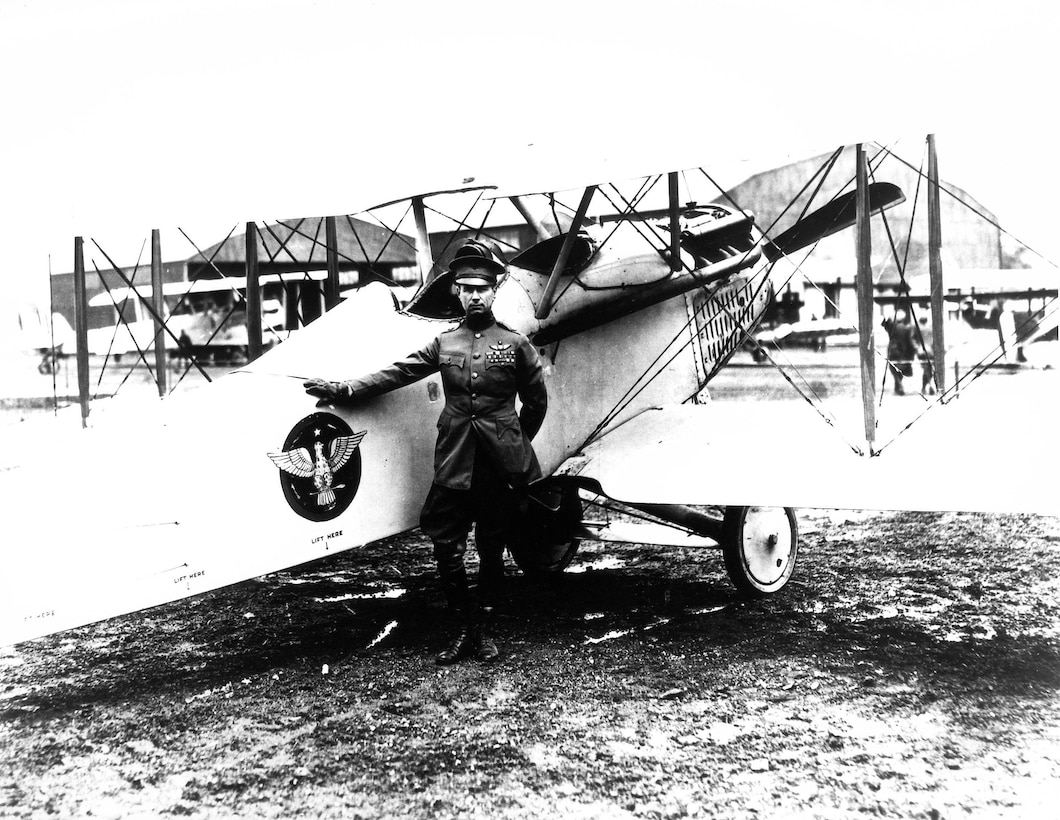 "Brig. Gen. William ""Billy"" Mitchell standing by a V.E. 7 at Bolling Field, D.C.  Air Tournament, May 14 -16, 1920. The Vought VE-7 Bluebird was an advanced military trainer, observer and fighter of World War I. (U.S. Air Force photo)"