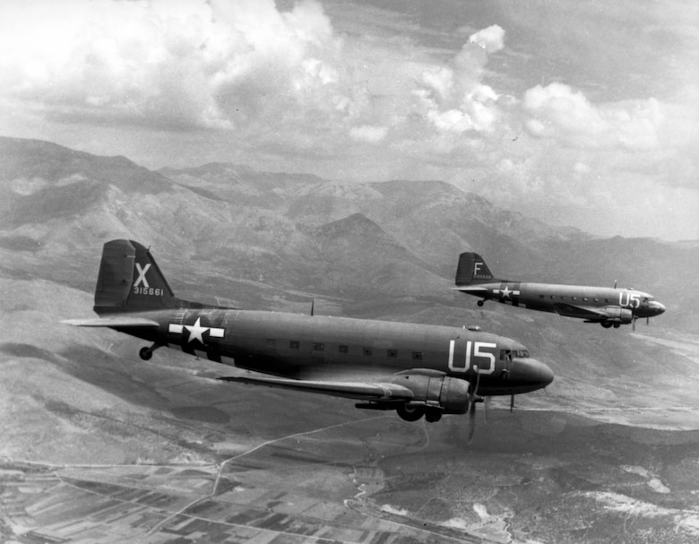 "1940's -- Douglas C-47 ""Skytrains"", 12th Air Force Troop Carrier Wing, loaded with paratroopers on their way for the invasion of southern France, 15 August 1944. (U.S. Air Force photo)"
