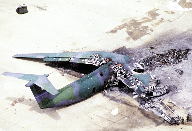 1990's -- POPE AIR FORCE BASE, N.C. -- An F-16 Fighting Falcon hit the tarmac in front of this C-141 Starlifter setting it on fire March 23, 1994.  The crash spread wreckage and burning fuel into an area where paratroopers waited to board the aircraft.  The accident killed 24 Soldiers and injured more than 100 others. (Courtesy photo)