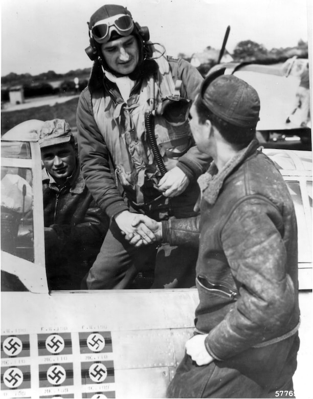 1940's -- Lt. Col. Frances S. Gabreski and Staff Sgt. Ralph Safford, crew chief, prepare for flight. The assistant crew chief is in the background.