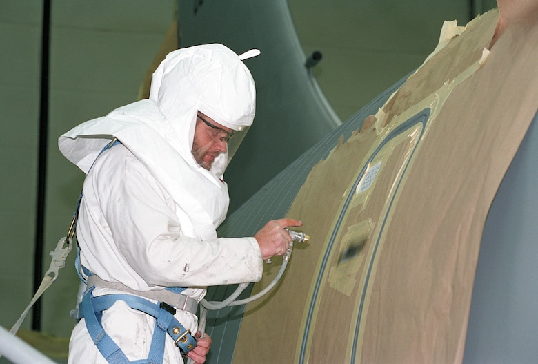 TINKER AIR FORCE BASE, Okla. -- Kenneth Kilgore paints stenciling on a KC-135 Stratotanker emergency exit door.  (U.S. Air Force photo by Margo Wright)