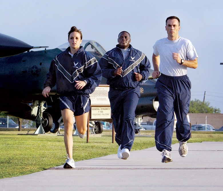 LACKLAND AIR FORCE BASE, Texas -- First Lt. Megan Schafer (from left), Staff Sgt. Antwain Wright and Master Sgt. Scott Wagers show off different combinations of the new physical training uniform while jogging here during the wear-test phase.  The new uniform will be issued to Airmen serving in Southwest Asia first and phased into the rest of the force over the next three years.  (U.S. Air Force photo by Master Sgt. Efrain Gonzalez)