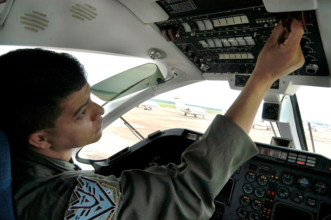 COLUMBUS AIR FORCE BASE, Miss. -- Capt. Terry Tyree Jr. adjusts the controls in a T-1A Jayhawk before a flight.  He earned his third aeronautical rating when he graduated from specialized undergraduate pilot training here recently.  He will learn to fly KC-10 Extenders at McGuire Air Force Base, N.J.  (U.S. Air Force photo by Airman 1st Class Alexis Lloyd)