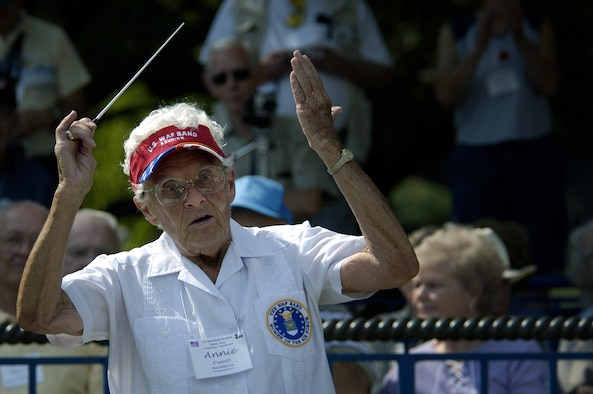DALLAS -- Annie Everitt, a former member of the U.S. Air Force Women in the Air Force Band, leads her fellow musicians during a concert here at this year's Texas State Fair.  At age 80, Ms. Everitt is the oldest participant at this year's WAF band reunion.  Her time with the band spanned nine years from 1952 to 1961.  While with the band, she was a trombone player and also the band's alternate conductor.  (U.S. Air Force photo by Master Sgt. Efrain Gonzalez)