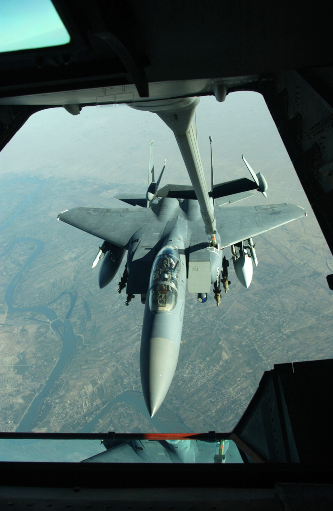 OVER IRAQ -- An F-15E Strike Eagle receives fuel from a 908th Expeditionary Aerial Refueling Squadron KC-10 Extender during a mission over Iraq.  (U.S. Air Force photo by Senior Master Sgt. Mark Moss)