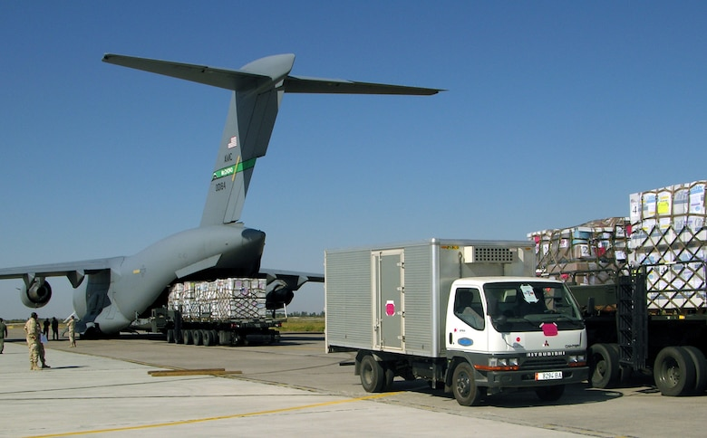MANAS AIR BASE, Kyrgyz Republic -- Trucks line up as Operation Provide Hope aid is unloaded from a C-17 Globemaster III from McChord Air Force Base, Wash., on Sept. 23.  More than $15 million worth of medicines and medical supplies were flown in.  (U.S. Air Force photo by Staff Sgt. Chuck Marsh)