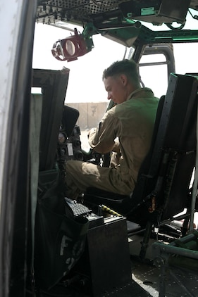 Lance Cpl. Damian M. Root, a crew chief for a UH-1N Huey from HMM-165 (REIN), 15th Marine Expeditionary Unit (Special Operations Capable), and native of Brunswick, Ga., conducts a cockpit check during some routine maintenance. The 15th MEU (SOC) is wrapping up one month of security and stabilization operations in the Greater Baghdad area