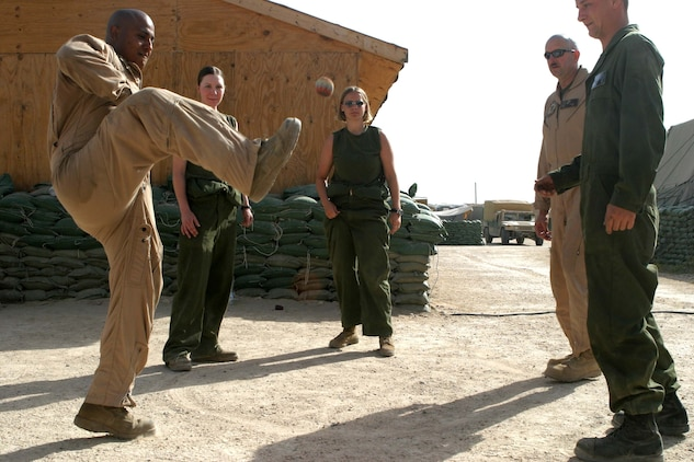 Marines of HMM-165 (REIN), 15th Marine Expeditionary Unit (Special Operations Capable) kill a little time by kicking a foot bag to each other. The 15th MEU (SOC) is wrapping up one month of security and stabilization operations in the Greater Baghdad area.