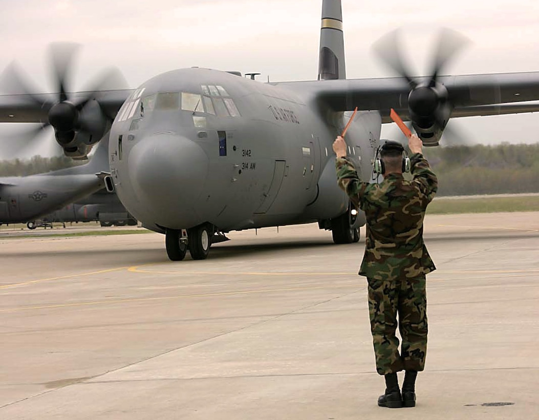 LITTLE ROCK AIR FORCE BASE, Ark. -- Tech. Sgt. Jonathan Rebidue marshals in the Air Force's second active-duty J-model C-130 Hercules here April 5.  Sergeant Rebidue is a C-130 dedicated crew chief.  (U.S. Air Force photo by Airman 1st Class Tim Bazar)