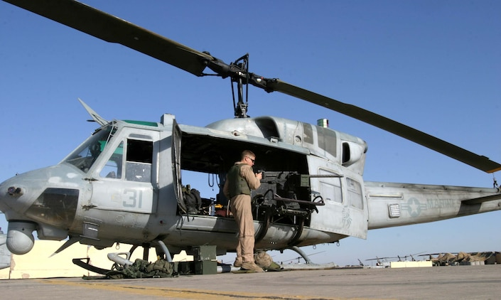 Cpl. Andrew B. Legg, a UH-1N Huey crew chief for HMM-165 (REIN), 15th Marine Expeditionary Unit (Special Operations Capable), prepares a .50 caliber machine gun before a mission. The 15th MEU (SOC) is wrapping up one month of security and stabilization operations in the Greater Baghdad area.