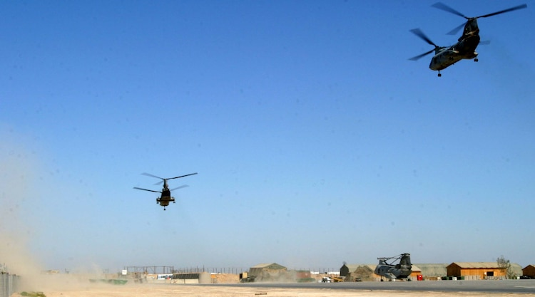 Two CH-46E Sea Knight helicopters from HMM-165, 15th Marine Expeditionary Unit (Special Operations Capable), take off for a mid-day mission. The 15th MEU (SOC) is wrapping up one month of security and stabilization operations in the Greater Baghdad area.