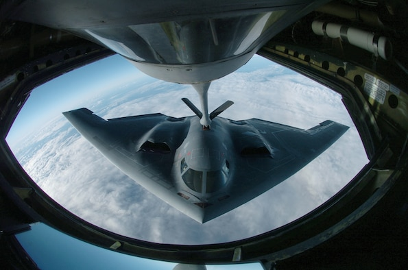 OVER THE PACIFIC OCEAN -- A B-2 Spirit bomber refuels from a KC-135 Stratotanker here during a deployment to Andersen Air Force Base, Guam.  The bomber deployed as part of a rotation that has provided U.S. Pacific Command officials a continuous bomber presence in the Asia-Pacific region, enhancing regional security and the U.S. commitment to the Western Pacific.  The Spirit is from the 509th Bomb Wing at Whiteman AFB, Mo.  The Stratotanker is assigned to the Illinois Air National Guard's 126th Air Refueling Wing at Scott AFB.  (U.S. Air Force photo by Master Sgt. Val Gempis)