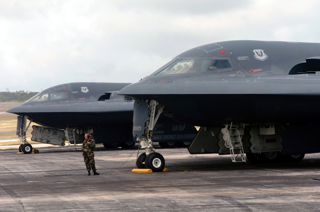 Senior Airman Mindy High prepares to launch a B-2 Spirit bomber during a mission at Andersen Air Force Base, Guam.  The B-2s deployed to Andersen AFB Feb. 25 to provide U.S. Pacific Command officials a continuous bomber presence in the Asia-Pacific region, enhancing regional security and the U.S. commitment to the Western Pacific.  Bomber aircraft have had an ongoing presence on the island since February 2004.  Airman High is a crew chief from the 509th Bomb Wing at Whiteman Air Force Base, Mo.  (U.S. Air Force photo/Master Sgt. Val Gempis)