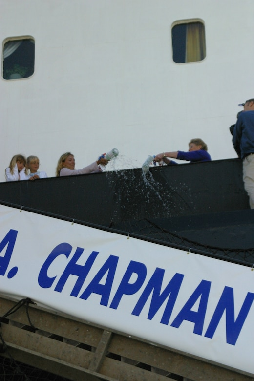 SUNNY POINT, N.C. -- Valerie Chapman (left) and Mickey Handy christen the MV Tech. Sgt. John A. Chapman on the ship's railing April 8. The women co-sponsored the ceremony. Mrs. Chapman is Sergeant Chapman's widow, and Mrs. Handy is Gen. John W. Handy's wife. (U.S. Air Force photo by Lisa Terry McKeown)