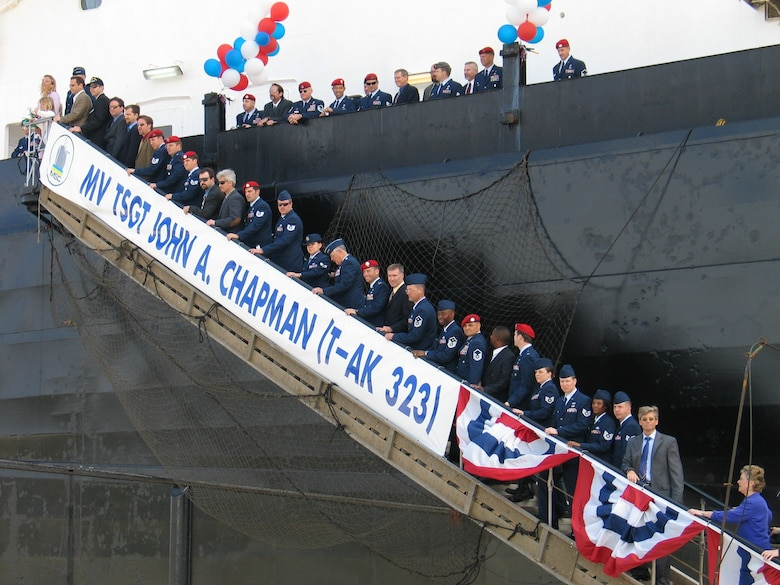 SUNNY POINT, N.C. -- Members of the special operations community join Gen. John P. Jumper, Valerie Chapman and her family on the gangplank of the MV Tech. Sgt. John A. Chapman here April 8 after the renaming of the ship. (U.S. Air Force photo by Michelle M. Butzgy)